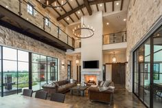 Contemporary italian farmhouse.  Double height living family with wood beams, stone walls, and stained concrete floors, #VanguardStudioInc