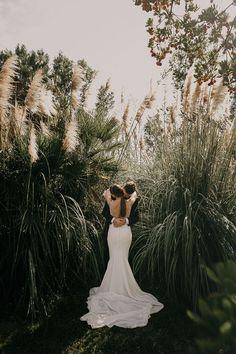 Wedding couple portrait among pampas grass | Image by Pablo Laguia