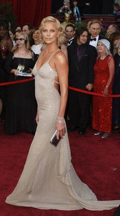 Charlize Theron - Oscars 2004 in Gucci.     I think she might be the only one who compares to any of the old movie stars...and Angelina, if she just smiled more.