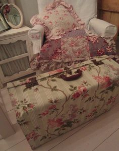 Inspiration for me to get a nice wallpaper and cover the outsides of some old luggage like this!