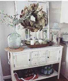 white lantern, wooden bowl, candles, green balls