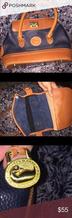 Dooney & Bourke Cute handbag a bit wear on the side nothing major . Dooney & Bourke Bags Totes