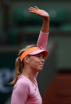 Maria Sharapova Photos Photos - Maria Sharapova of Russia celebrates victory during her women's singles match against Tsvetana Pironkova of Bulgaria on day four of the French Open at Roland Garros on May 28, 2014 in Paris, France. - French Open: Day 4