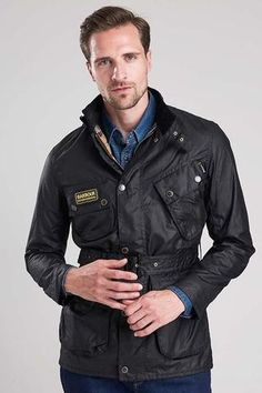 Smyths  Barbour International Slim International Wax Jacket in Black wax cotton MWX0958BK91 is slim fitting, best selling and on offer at £225. The jacket  is b