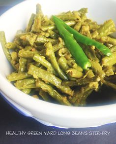 Recipe – HEALTHY GREEN YARD LONG BEANS STIR-FRY Yard long beans known as chawli in hindi and achinga payar in malayalam is a healthy and nutritious vegetable. Easy and very simple to make with minimal ingredients available in the kitchen. Thin, long and slender; it comes in 3 different colours, light green, dark green and purple. The dark green yard long beans is used here in this recipe. Back home, we use the light green ones which I feel is tastier. In case the beans are matured, tear open