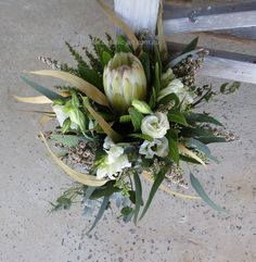 Native bouquet with white protea and gold leaves for a bit of sparkle.