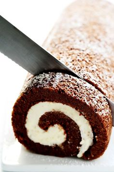 "amazing Chocolate Roll Recipe (a. ""Chocolate Swiss Roll"") is easy to customize with your favorite fillings (cream cheese is my fave! Plus, it's also easy to make ahead and freeze. Perfect for holiday entertaining, and even giving away as gifts! Köstliche Desserts, Chocolate Desserts, Delicious Desserts, Dessert Recipes, Chocolate Cake Roll, Chocolate Swiss Roll Recipe, Chocolate Cupcakes, Chocolate Ganache, Swiss Desserts"