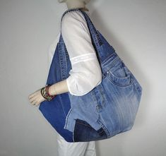 Special order for Toy Bailey Details as discussed. One of a kind handmade denim tote bag. Very unusual and stylish tote! Totally crazy in design and shape! Raw edges, different shades of denim. For you to stand out, as it is truly unique thing! Oversized tote bag, which is perfect