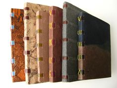 Longstitch books over tapes by Susan Mills. Longstitch bindings date back to medieval times. This variation is sewn over visible leather thongs. The thongs lace into the cover at the spine and emboss the front and back covers like 'ribs'. This binding is adaptive to many different weights of text paper.