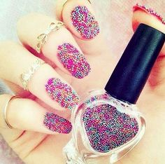 18 3D Nails - Caviar nails never looked better.