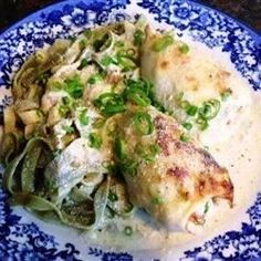 Calamari tubes are stuffed with seafood and baked in a rich cream sauce before serving over a bed of linguine. This is probably the best calamari, if not the best entree, you'll ever have!