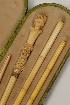 A cased ivory traveling cane with a glove stretche - by Tradewinds Antiques
