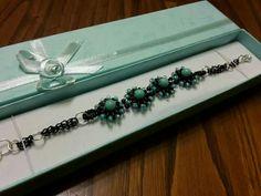 Braccialetto perline e catena. Seguiteci su Facebook 👍