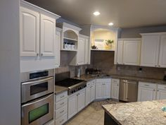 Kitchen refinished in SW dover white by Chameleon Painting SLC, UT. Refinishing Cabinets, Kitchen Refinishing, Kitchen Cabinets, Cabinet, Refinishing Furniture, Dover White, Home Decor, Kitchen, Laundry Room Cabinets