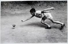 Giorgio Casali - Little boy playing bowls