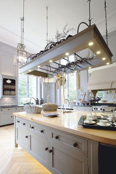 This handmade island from Chalon is the centrepiece of the room. Rather than it simply being a practical cooking station, it has been turned into a feature with spotlighting from above and accent lighting around its base.