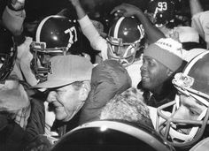 1982 - Alabama football coach Paul 'Bear' Bryant is surrounded by players after his last game as head coach of The Crimson Tide in the Liberty Bowl on December 29. Alabama beat Illinois 21-15.