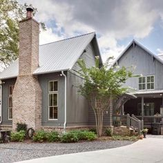 How charming is this rustic farmhouse? The combination of grey cypress, brick and blue door are magnificent! The interior is gorgeous too! Modern Farmhouse Exterior, Rustic Farmhouse, Metal Roof, Modern Rustic, My Dream Home, Dream Homes, Exterior Design, Exterior Paint, Custom Homes