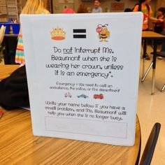 Here's a nice idea for a signal that the teacher is doing important work and is not to be distrubed!