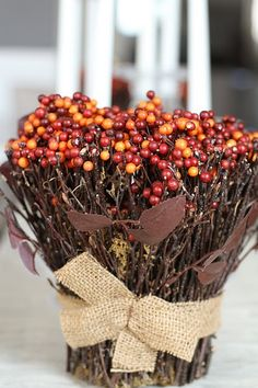 stick and berry arrangement- glue sticks around old tin can, add burlap bow and fill with fall berries - love it