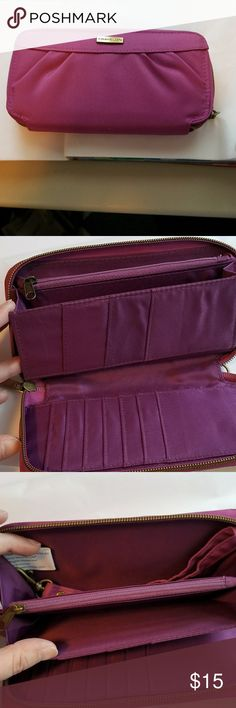 NWOT 🚨 Travelon RFID Purple Clutch Wallett NWOT 🚨Travelon RFID Purple Signature Pleated Single Zip Clutch Wallett. Effectively blocks RFID readers from capturing information from your cards. Also has a removable matching strap. No tears and no stains and from smoke free home. Travelon Bags Clutches & Wristlets