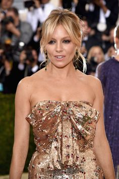 Pin for Later: See Every Elegant Beauty Look From the Red Carpet at the Met Gala Sienna Miller The bohemian goddess wore her hair in a tousled, sexy updo. Key product: Burberry Full Kisses in Nude Blush No.501 ($30)