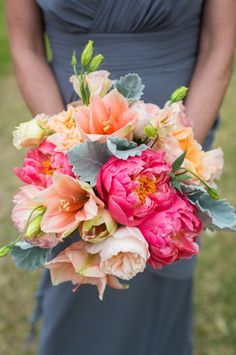 this stunning peach and pink bouquet takes our breath away! see more beautiful work from Danna Cubbage Weddings here http://www.weddingchicks.com/vendor-guide/dana-cubbage-weddings/