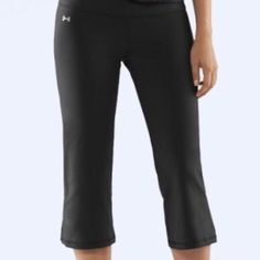 Under Armour Heat Gear Capri workout/yoga Pants Black pair of Under Armour workout or yoga pants. Size XS. Not tight around the calf area (as in cover photo). Under Armour Pants Capris