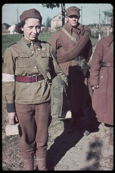 Polish soldiers and a Red Cross nurse captured during the invasion of Poland, Hugo Jaeger—The LIFE Picture Collection/Getty Images Luftwaffe, Invasion Of Poland, Poland Ww2, Female Soldier, Military Personnel, Red Cross, Women In History, Military History, Churchill