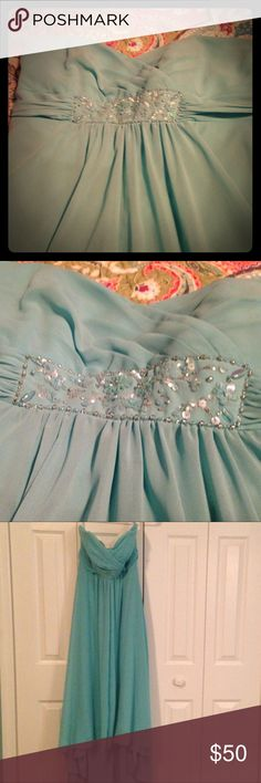 Davids Bridal Gown Strapless asymmetrical turquoise gown with decretive beading under bust. Worn once for a wedding. Please note: Once I took it out of my closest to post, noticed small light brown blemish on back towards the bottom. See last pic. davids bridal Dresses Asymmetrical