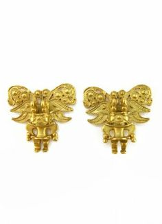 Tairona Embossed Zoomorphic Figure Earrings Across The Puddle. $30.00. Charm: Zoomorphic Figure. Pre-Columbian Culture: Tairona. Handcrafted. Museum Quality Reproduction. Numbered Certificate and Jewelry Box or Velvet Bag included