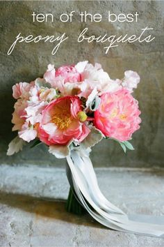 Coral peony bouquet with silvery dusty miller leaves &; mint ribbons