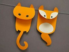 Paper critter garland idea - glued where the string runs under the heads?