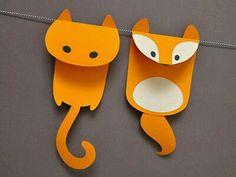 Paper critter garland idea - glued where the string runs under the heads?