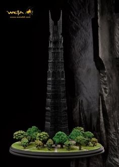 Orthanc - The Black Tower Of Isengard Diorama, WETA WT00971 Orthanc - The Black Tower Of Isengard Diorama. It is made by WETA and is approximately 43 cm (16.9 in) high    In a great black tower in Isengard dwells Saruman the White. Before the great wizard was turned to the dark side, in the time when Gandalf sought council with Saruman - the head of his order - Isengard was lush and green and its gardens lent themselves well to a contemplative stroll.   This Orthanc is the inspiration for…