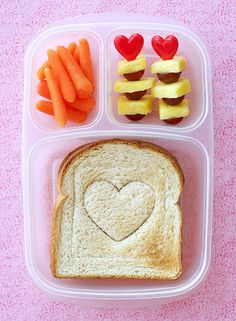 Be Mine: Valentine's Day Lunch Box Idea: Fruit kebabs — made using plastic cupcake heart picks — and a sandwich with a heart stamp make a lovely Valentine's Day lunch box idea —and nutritious, too! Source: Lisa Storms