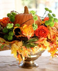 Easy Fall arrangement using a faux pumpkin. Create a beautiful fresh floral arrangement with a faux pumpkin and grapevine wreath. Faux Pumpkins, Fall Arrangements, Autumn Decorating, Decorating Ideas, Thanksgiving Centerpieces, Thanksgiving Ideas, Fall Harvest, Apple Harvest, Fall Crafts