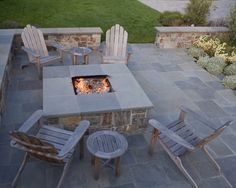 Like the firepit table except maybe a rectange and less substantial. Like the stone patio and benchwall but stucco, not stone. Contemporary Square Outdoor Patio Fire Pits Design