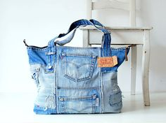 Unique handmade denim bag with a vintage look! On the bag you can find lots of pockets, leather details, a brown / gold metal zipper on top. This jeans bag is made of an old Levis 501, the original features have been incorporated into the new design; distressed parts, Levis button, leather