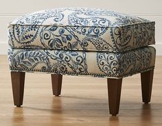 An overscaled paisley print makes the Brielle ottoman an instant statement piece for the living room. Designed to pair with our Brielle wing chair, this cushioned ottoman is outlined by hand-applied, platinum-finished nailheads that align edge to edge.