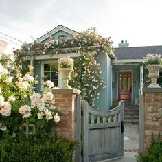You can't go wrong with adding a little natural charm to your boost your curb appeal! This cottage-style home is dressed in a fresh blue-green backdrop for the lush array of colorful flowers. Love this look? Tap the link in our bio for more beautiful home exteriors