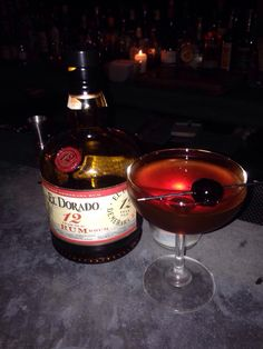 "El Dorado 12 Year Demerara ""Manhattan"" with Carpano Antica Formula Vermouth, Angostura & Orinoco Bitters; stirred & served UP^ with a Brandied Cherry & a discarded Orange Twist - simple luxury!"