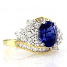 Oval Tanzanite Bypass Ring w/ Diamond Cluster in Two Tone 18K Gold
