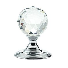 Facetted Clear Glass Ball Door Knobs on Polished Chrome Roses - The Facetted Clear Glass Ball Door Knob is an excellent addition to any door. The polished chrome finish will add a luxurious look to any room. This knob is also available in a variety of coloured glass and roses