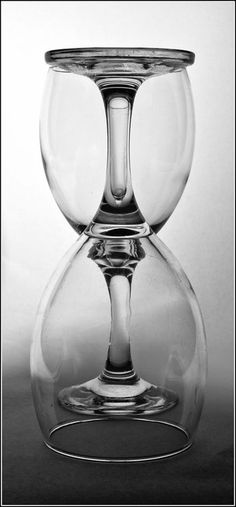Two glasses that together form an hourglass.