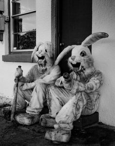 PHOTO WITH DISTURBING UNDERTONES. RABBIT COSTUMED FIGURES, LOOKING LIKE THEY MIGHT HAVE JUST COMMITED A GRIZZLY CRIME. VIA GOOGLE SEARCH