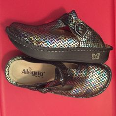 Alegria Metallic Snakeskin Professional Clogs So cute! These clogs are the most comfortable shoes you can buy! Chosen by many professionals that are on their feet all day. Snakeskin metallic print has iridescent aqua blues, gold, pinks and black. Leather uppers.  Bought 3 pairs in a size too large  ended up buying one size smaller. Worn once! Size euro 37 - US 7. Alegria Shoes Mules & Clogs