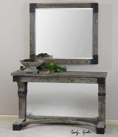 "A perfect rustic element for the rough side of your Rough Luxe inspired room.  ""The Nelo mirror and console are from the barn wood school. The warm-colored, rusty metal plays against the cool grey finish. The texture is real and the shape is not ordinary but also not fancy."" Carolyn Kinder, Founder, Carolyn Kinder International"