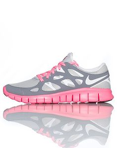 NIKE Low top women's running sneaker Lace up closure Mesh throughout Flexible material for ultimate comfort Cushioned sole Grey with pink accents... Ahhhh! i want it!!