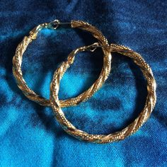 """Twisted cable hoop gold tones earrings Funky and classy all in one. Diameter is 1.75"""". Posts with flip secure back. EUC Jewelry Earrings"""
